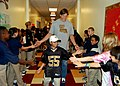 US Navy 071113-N-7427G-004 Scott Fujita, a member of the New Orleans Saints, greets more than 200 students of Belle Chasse Academy during a tour of the school as a part of the National Football League's Campaign 60 program.jpg