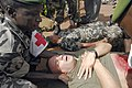 US Navy 080718-F-5588D-641 Malian medical personnel prepare to move U.S. Navy Petty Officer 3rd Class Scott Ott during a simulated mass casualty accident.jpg