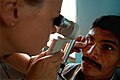 US Navy 080815-N-7540C-070 Lt. Megan Rieman, a medical augmentee embarked aboard the amphibious assault ship USS Kearsarge (LHD 3), conducts an eye exam for a Nicaraguan man at a medical clinic.jpg