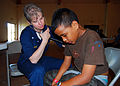 US Navy 080826-N-6387D-030 Cmdr. Michele Gasper examines 13-year old boy.jpg