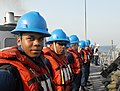 US Navy 080909-N-3610L-030 Seaman London Teal stands in formation with crewmembers aboard the guided-missile frigate USS Thach (FFG 43) as the ship prepares to receive fuel during a replenishment at sea.jpg