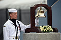 US Navy 080911-N-0696M-003 A Sailor rings a bell as the name of each person lost at the Pentagon is read during the Pentagon Memorial dedication ceremony Sept. 11, 2008.jpg