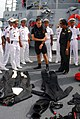 US Navy 081014-N-2013O-001 Gunner's Mate 2nd Class Joshua Flamand talks about the equipment used by search and rescue swimmers with sailors from the Royal Cambodian navy.jpg