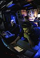 US Navy 090420-N-9928E-233 Sonar Technicians (Surface) track and report simulated mines during an under-sea warfare training scenario in the sonar room aboard the Arleigh Burke-class guided-missile destroyer USS Kidd (DDG 100).jpg