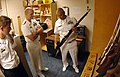 US Navy 091010-N-1928O-016 Chief Mark Stauder, Naval Science Instructor for the Navy Junior ROTC program at Easley High School, shows a ceremonial rifle to Rear Adm. Bill Goodwin.jpg