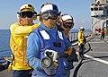 US Navy 100123-N-1082Z-051 Sailors aboard the amphibious dock landing ship USS Ashland (LSD 48) participate in a flight deck firefighting drill.jpg