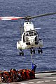 US Navy 100228-N-7918H-217 A Sailor hooks a pole pendant to a commercial SA 330J Puma helicopter.jpg