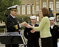 US Navy 100421-N-2389S-022 Cmdr. Justin Shineman, commanding officer for Navy Recruiting District Minneapolis, gives a modern cannon shell to a representative of the governor of Des Moines as a thank you from the Navy during De.jpg