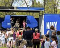 US Navy 100515-N-8557T-784 Spectators queue to board the Navy Flight Simulator in Riverside Park during Spokane Navy Week.jpg
