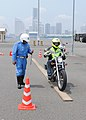 US Navy 100702-N-2218S-002 Sailors practice their motorcycle skills and safety techniques with Shirobai, elite Japanese motorcycle police officers.jpg