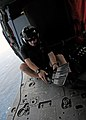 US Navy 101014-N-5016P-167 Naval Air Crewman 2nd Class Wesley Evans, assigned to Helicopter Sea Combat Squadron (HSC) 12, dons his rescue swimmer g.jpg