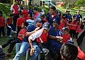 US Navy 110607-N-NJ145-074 Malaysian and U.S. Navy Sailors play musical chairs with children from the Rumah Kanak Orphanage during a Cooperation Af.jpg
