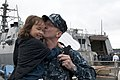 US Navy 110822-N-SF508-046 IT1 Christopher Binnings kisses his daughter after a long, summer patrol.jpg