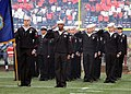 US Navy 111113-N-GT710-006 Sailors salute during the national anthem during a Military Appreciation Day football game at Century Link Field as the.jpg