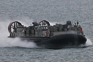 US Navy 120111-N-UM734-163 A landing craft air cushion approaches the well deck of the amphibious assault ship USS Kearsarge (LHD 3).jpg