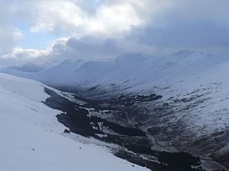 Glen Shiel - Part of the afforested section of Glen Shiel looking south-east from the slopes of Sàileag, with the A87 running up to Loch Cluanie (out of sight, top left)
