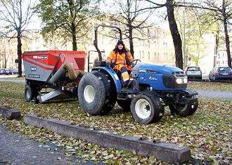 Lawn sweeper - Vacuum sweeper towed by a tractor in Sweden