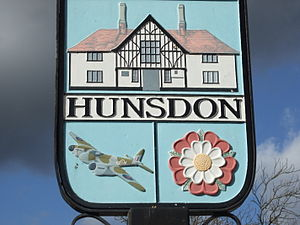 Hunsdon - Village sign with RAF Mosquito included in the design