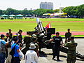 Visitor Pulling Firerope of M114A1 155mm Howitzer Exercise in Front of Zhongzheng Hall 20140531.jpg