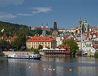 Vltava River, Church of Saint Nicholas at Malá Strana, Malá Strana Bridge Tower, Basilica of the Assumption in the Strahov Monastery. Prague, Czech Republic.jpg