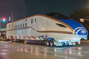W7 Series Shinkansen - Car 12 of set W11 being transported to Hakusan Depot by road in August 2015