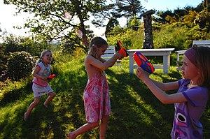 Water gun - Children fighting with water guns