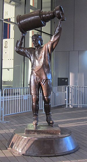Wayne Gretzky - A statue, located outside Rogers Place in Edmonton, of Gretzky hoisting the Stanley Cup, which the Oilers won four times with him. Sculpted by John Weaver.