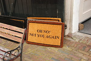 Mat - A doormat with a not very welcoming message