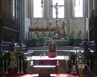 Bamberg Cathedral - Western choir with Volksaltar, chandelier, choir stalls and cathedra. Kreuzaltar in the back