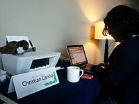 Wikimania 2015-Tuesday-Wendy the Weasel working together with Christian Cariño.jpg