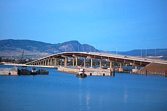 William R. Bennett Bridge - The bridge seen from West Kelowna, with parts of the old bridge still visible in the foreground