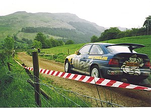 Ford Escort RS Cosworth - A Ford Escort RS Cosworth on a stage rally, driven by British driver Malcolm Wilson.