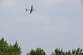 World War II era planes fly over Washington, D.C. seen from Arlington National Cemetery (17243946688).jpg