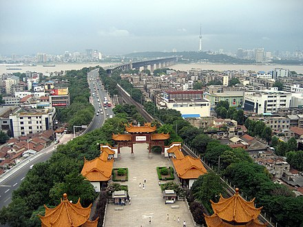 Looking west from the Yellow Crane Tower in Wuchang. The First Bridge over the Yangtze, and the Tortoise Hill in Hanyang, with its TV tower, are in the background. Wuhan from Yellow Crane Tower.jpg