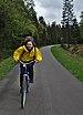 Yellow cyclist bicycling down the Vennbahnweg in Raeren, Belgium (DSCF5866).jpg