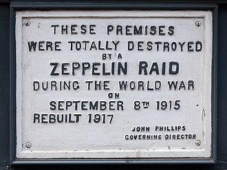 Farringdon Road - Plaque commemorating a Zeppelin raid on 61 Farringdon Road.
