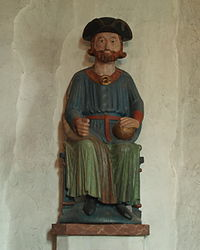 Statue of Saint Olaf wearing a tricorne uniform hat.