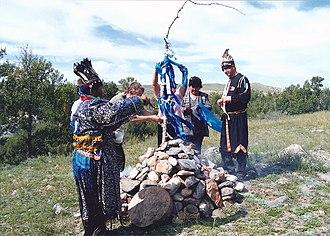 Shamanism in Siberia - Buryat shaman Tash Ool Buuevich Kunga consecrating an ovoo.