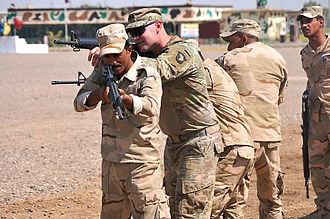 A trainer with Company A, 1st Battalion 502nd Infantry Regiment, Task Force Strike, 101st Airborne Division assisting Iraqi army ranger students during a room clearing drill at Camp Taji, Iraq on 18 July 2016 101st-Airborne-Soldiers-build-elite-Iraqi-force-with-Ranger-Training-7-480x319.jpg