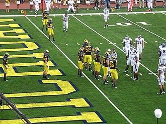 2010 Michigan Wolverines football team - Michigan offense including No. 16 Denard Robinson, No. 20 Michael Shaw, No. 22 Darryl Stonum, No. 12 Roy Roundtree, No. 86 Kevin Koger, No. 52 Stephen Schilling, and No. 50 David Molk as well as No. 79 Perry Dorrestein, No. 65 Patrick Omameh, and No. 72 Mark Huyge