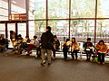 2014TIBE Day6 Hall1 Visitors Set on Chair Eating Lunch Boxes 20140210.jpg