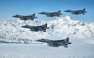 Eglin Air Force Base - Five F-15Cs from the 33d Fighter Wing of Eglin Air Force Base fly over an Alaskan mountain range during a deployment to Elmendorf Air Force Base, Alaska.