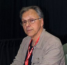 Chaykin seated at a table