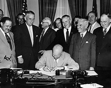 Eisenhower signs the legislation that changes Armistice Day to Veterans Day, June 1, 1954 72-901-1 HR7786 Veterans Day June 1 1954.jpg