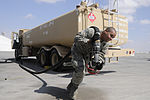 A1C Eric Castro, 380th Expeditionary Logistics Readiness Squadron fuels operator pulls the hose out to refuel an E-3 Sentry.jpg