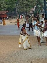162px A Kerala family in traditional kerala dress at guruvayur temple