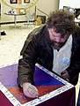 A One Iowa supporter signs a poster (4263423599).jpg
