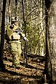 A U.S. Marine Corps officer with Bravo company, The Basic School (TBS), patrols the woods during a patrol to ambush field exercise at Camp Barrett, Marine Corps Base Quantico, Va., March 13, 2014 140313-M-RO295-111.jpg
