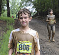 A young participant of the Annual Run-a-Muck watches other runners finish the 3.5 mile race at Marine Corps Base Quantico, Va., June 8, 2013 130608-M-AC520-387.jpg