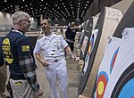 Adm. John Richardson receives an archery demonstration from Team Navy (34842160514).jpg